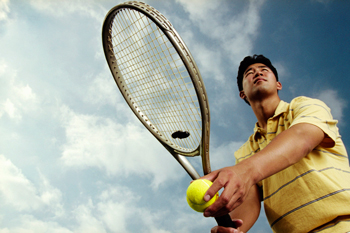 picture of man playing tennis